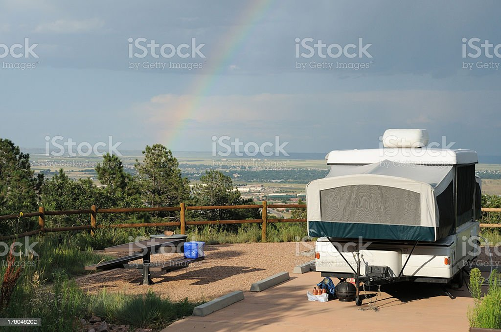 Popup in campground with rainbow stock photo