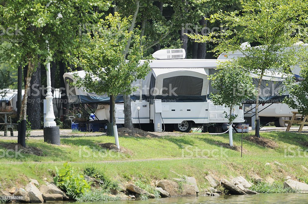 Popup rv trailer in campground stock photo