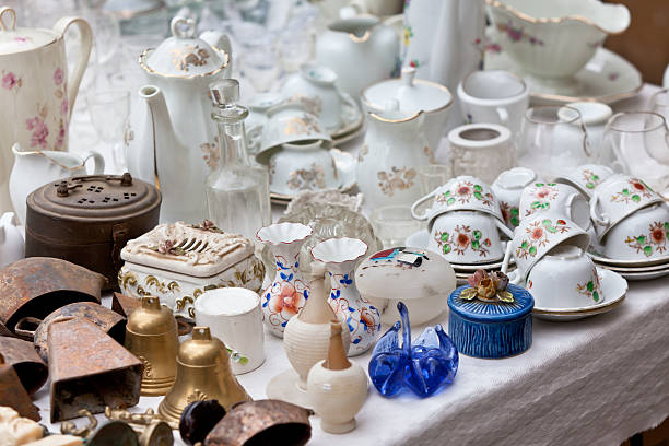 porcelain at a flea market - figurine stock photos and pictures