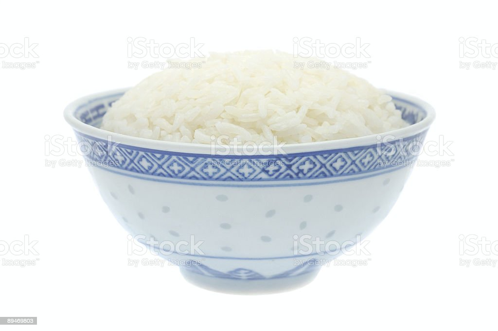 Porcelain bowl of cooked steamed rice on white background royalty-free stock photo