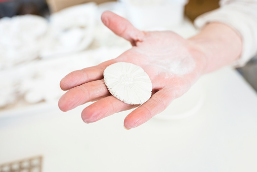 Porcelain clay in a woman's hand