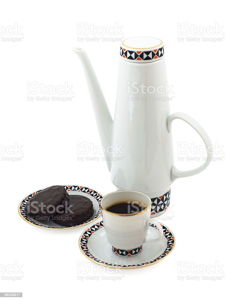 Porcelain coffeepot with coffee cup and chocolate biscuits royalty-free stock photo