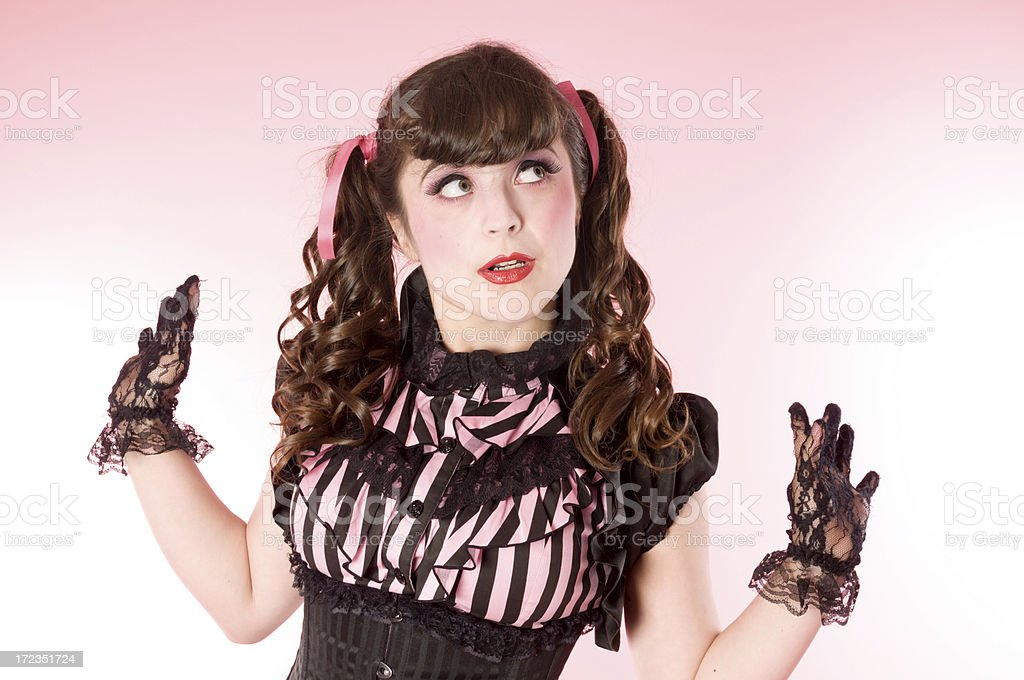Porcelain doll model with hands out, looking away. royalty-free stock photo
