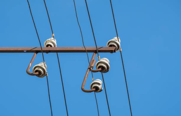 porcelain electric insulator, electricity pylon stock photo