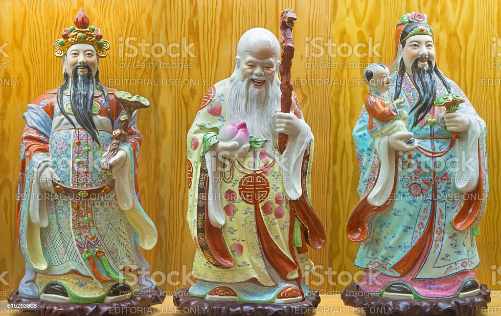 Porcelain  figure of Fu, Lu, Shou - Prosperity, Happiness, Longevity stock photo