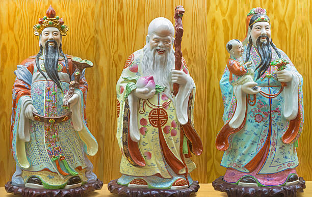 Porcelain  figure of Fu, Lu, Shou - Prosperity, Happiness, Longevity stock photo