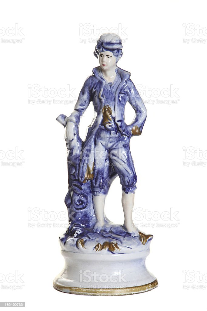 porcelain figurine boy-page stock photo