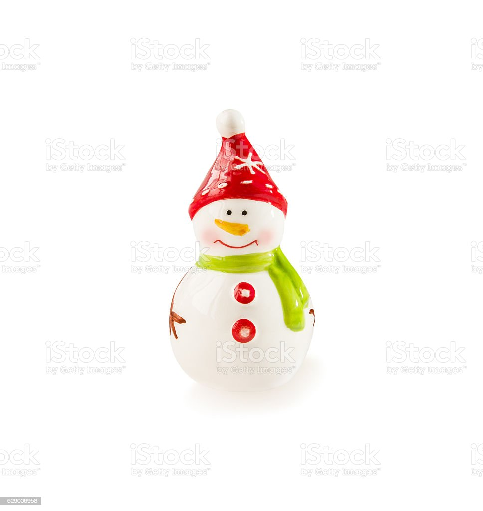 Porcelain figurine Snowman on white. Christmas and New Year them stock photo