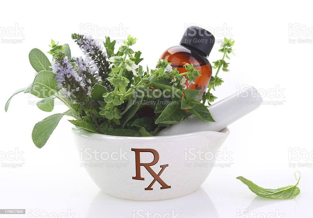 Porcelain mortar with rx symbol and fresh herbs royalty-free stock photo