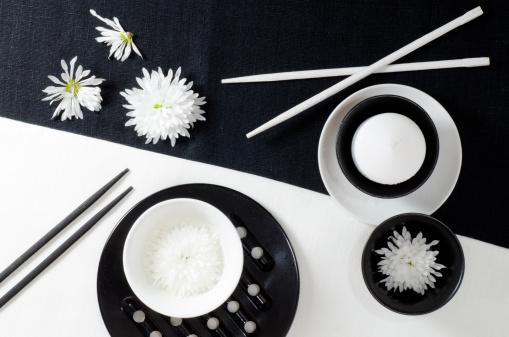 Porcelain on black and white linen tablecloths.