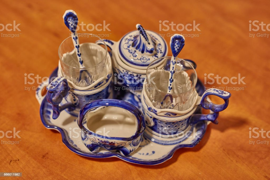 Porcelain set placed on orange wooden surface stock photo