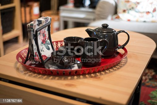 Porcelain Teapot, Creamer And Cups On Table