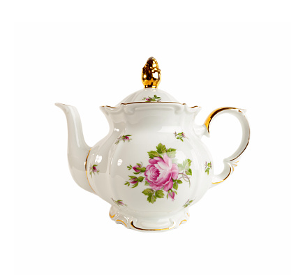 Porcelain teapot in classic style on white