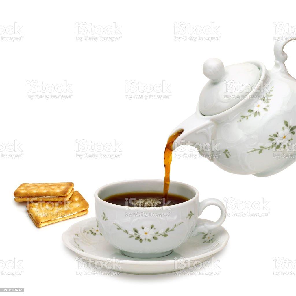 porcelain teapot pouring tea stock photo