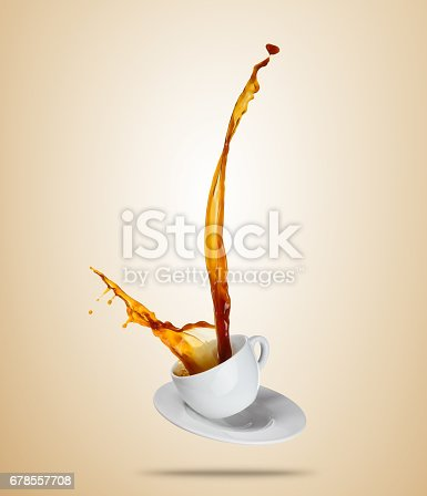 istock Porcelaine white cup with splashing coffee or tea liquid separated on brown background. 678557708