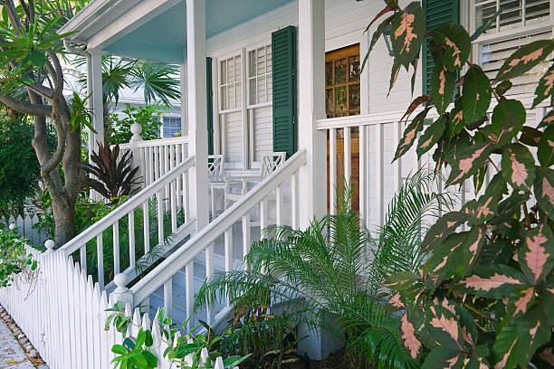 porch and fence along quiet street in key west florida porch and picket fence along quiet side street in key west florida southern usa stock pictures, royalty-free photos & images