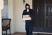 istock Porch Pirate Steals Packages Horizontal 1213025195