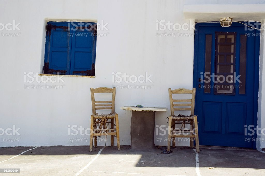 Porch with chairs of a Greek fisherman house royalty-free stock photo