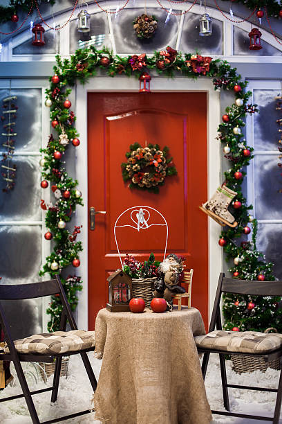 Porch with red door with Christmas wreath - Photo