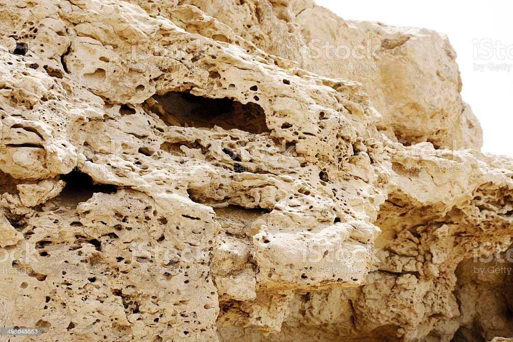 Pores visible in the outcrops of weathered limestone rock stock photo