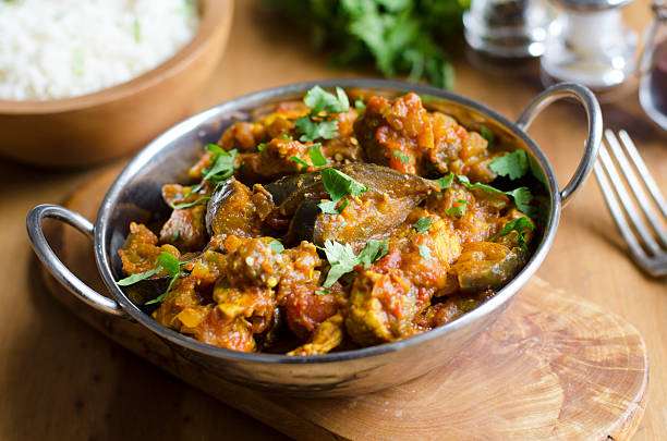 Pork and aubergine curry Pork curry with aubergine and red lentils  balti dish stock pictures, royalty-free photos & images