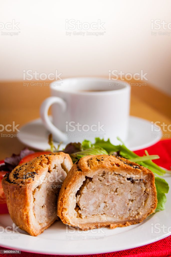 Pork and bramley apple pie with salad and hot drink royalty-free stock photo