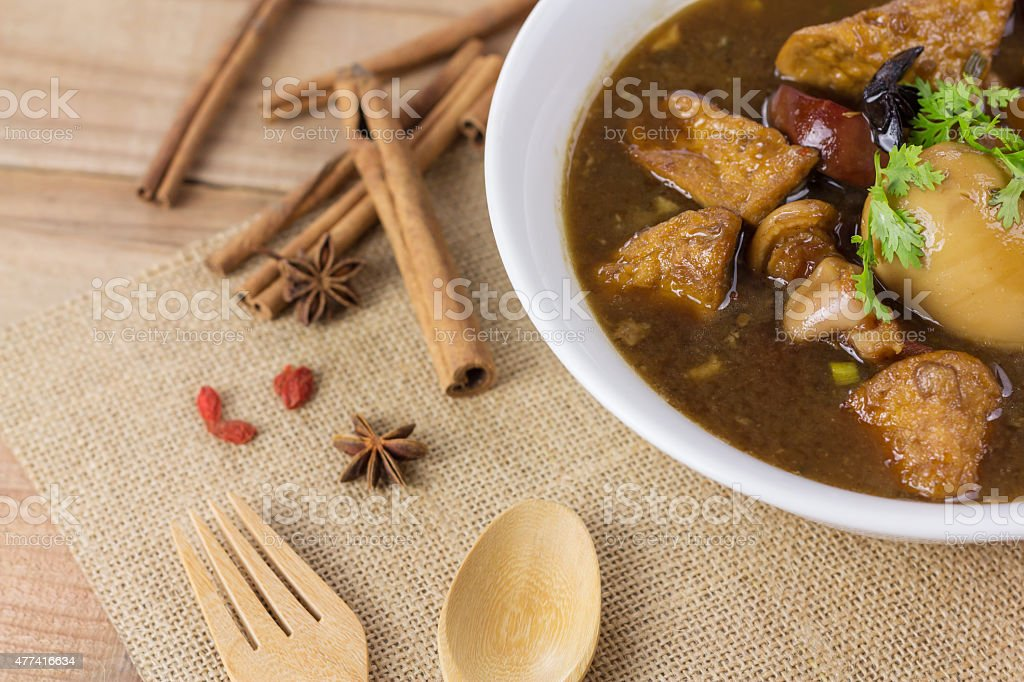 Pork and egg stewed in the gravy on wooden table 免版稅 stock photo