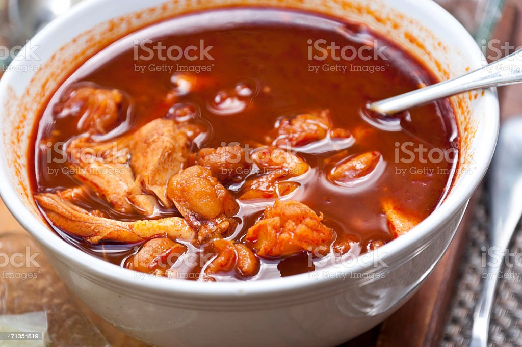 Pork and Hominy Stew with Red Chiles (Pozole Rojo) stock photo