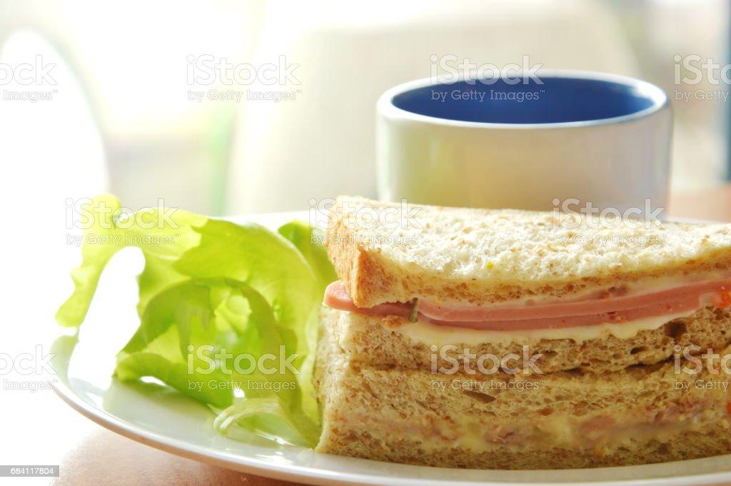 pork bologna whole wheat sandwich with fresh green oak and coffee royaltyfri bildbanksbilder