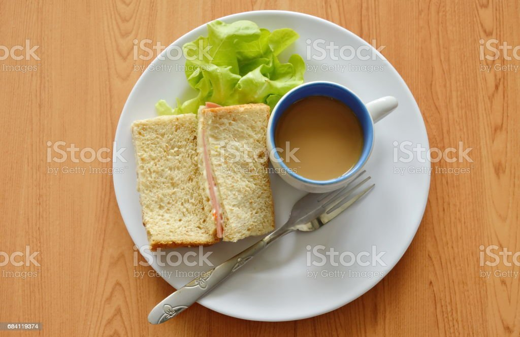 pork bologna whole wheat sandwich with fresh green oak and coffee foto stock royalty-free