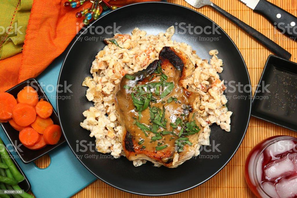 Pork Chop and Honey-Mustard Pan Sauce stock photo