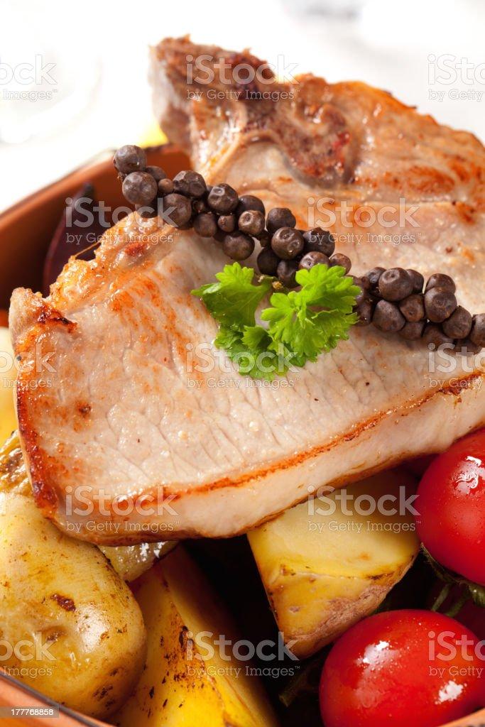 Pork chop and potatoes royalty-free stock photo