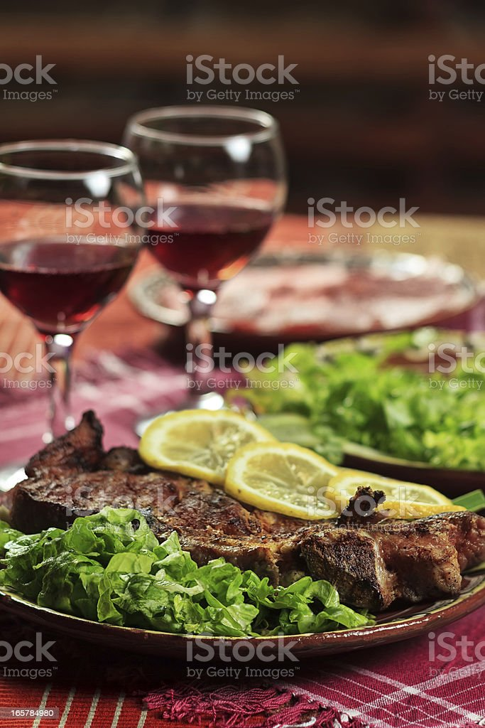 Pork chop and red wine royalty-free stock photo