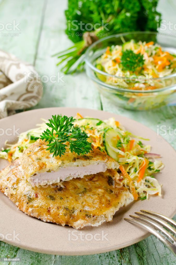Pork chop in batter with vegetable salad stock photo