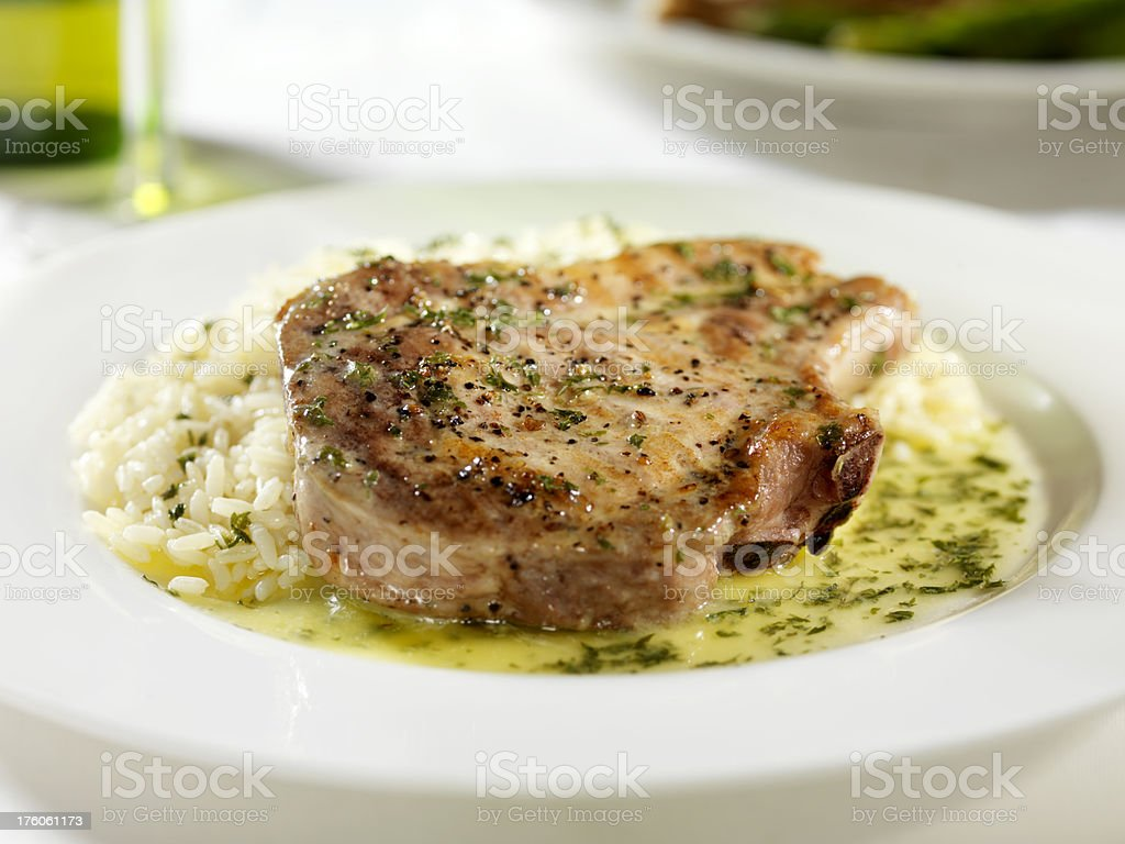 Pork Chop with a Butter Herb Sauce and Rice 1 royalty-free stock photo