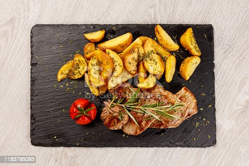 Pork chops in honey sauce with roasted potatoes