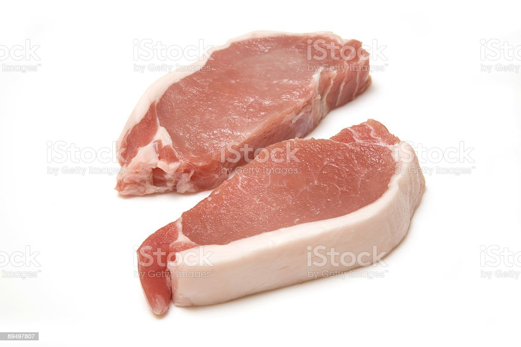 Pork chops isolated on white royalty free stockfoto