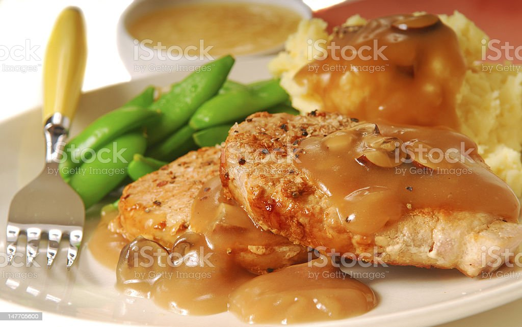 Pork chops with beans and mashed potatoes royalty-free stock photo