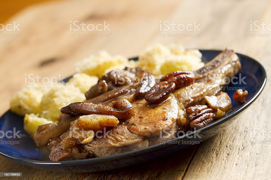 Pork chops with Carmelized Apples and Pecans royalty-free stock photo