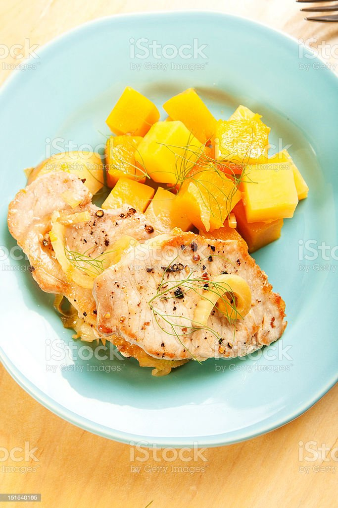 Pork chops with fall vegetables royalty-free stock photo