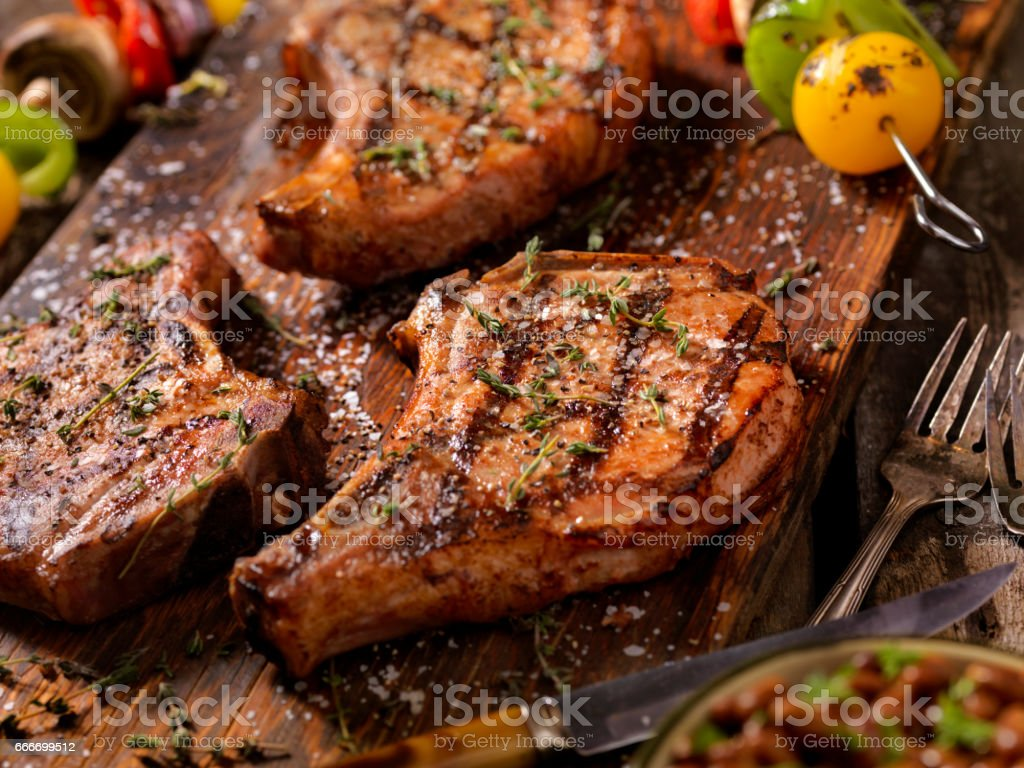 BBQ Pork Chops With Vegetable Skewers stock photo