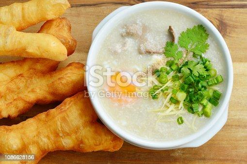 Pork congee with deep-fried dough stick. Rice porridge  with liver,minced pork,egg and deep - fried dough stick .