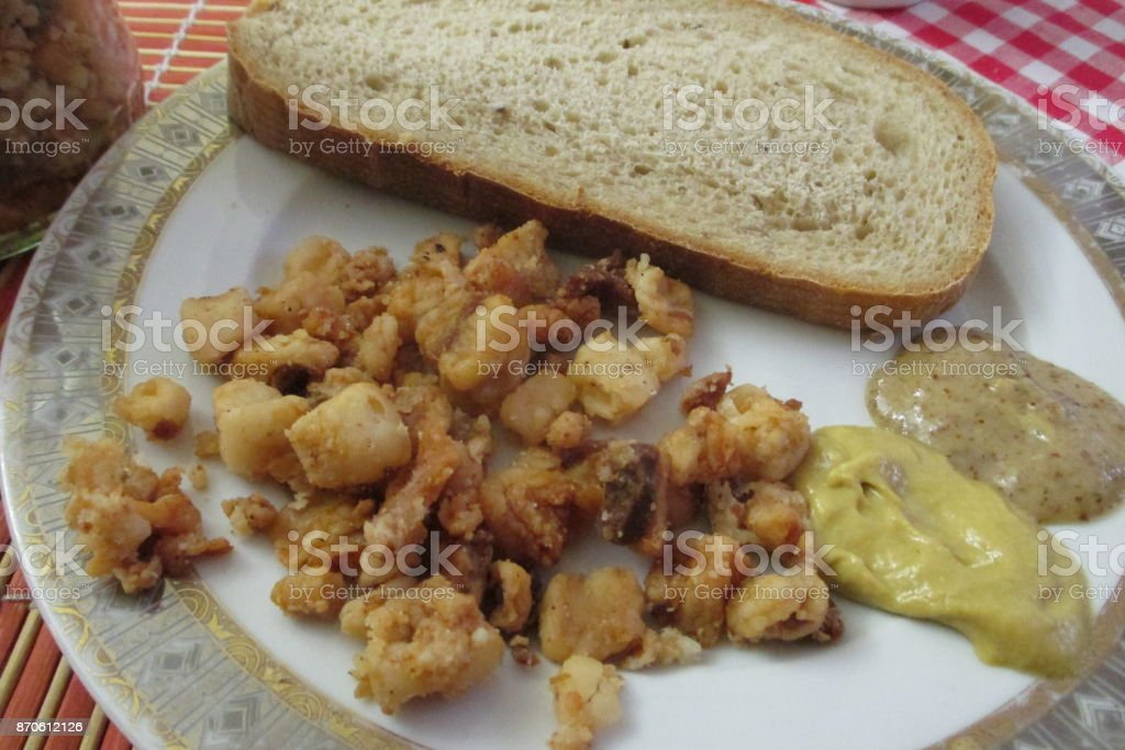 Pork crackle with mustard and bread stock photo