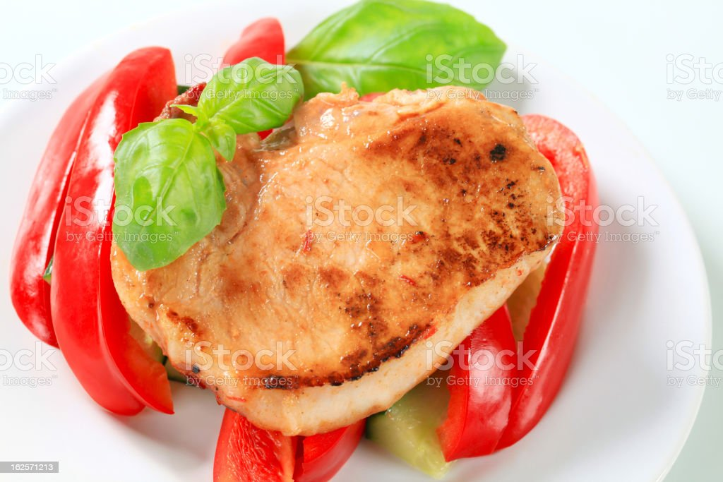 Pork cutlet with red pepper and zucchini sticks royalty-free stock photo