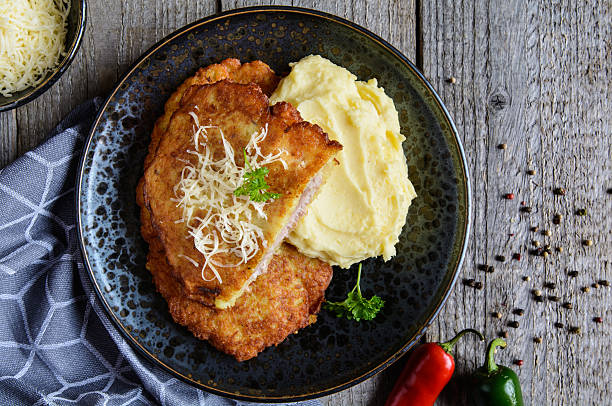 pork cutlets coated in potato batter, served with mashed potatoes - escalope imagens e fotografias de stock