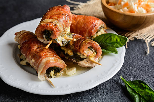 pork cutlets wrapped in bacon, stuffed with cheese and spinach - escalope imagens e fotografias de stock