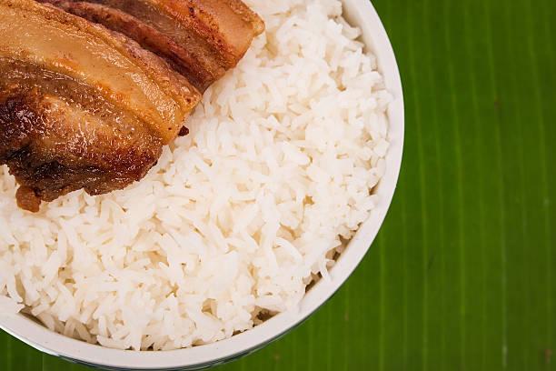 pork fried and  rice on banaba leaf stock photo