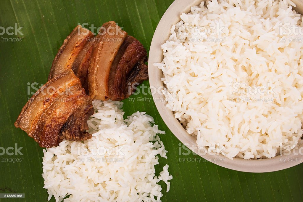 pork fried and  rice on banaba leaf stock photo