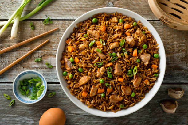 Pork Fried Rice Delicious pork fried rice with egg, carrot, green peas, garlic and green onion. fried rice stock pictures, royalty-free photos & images