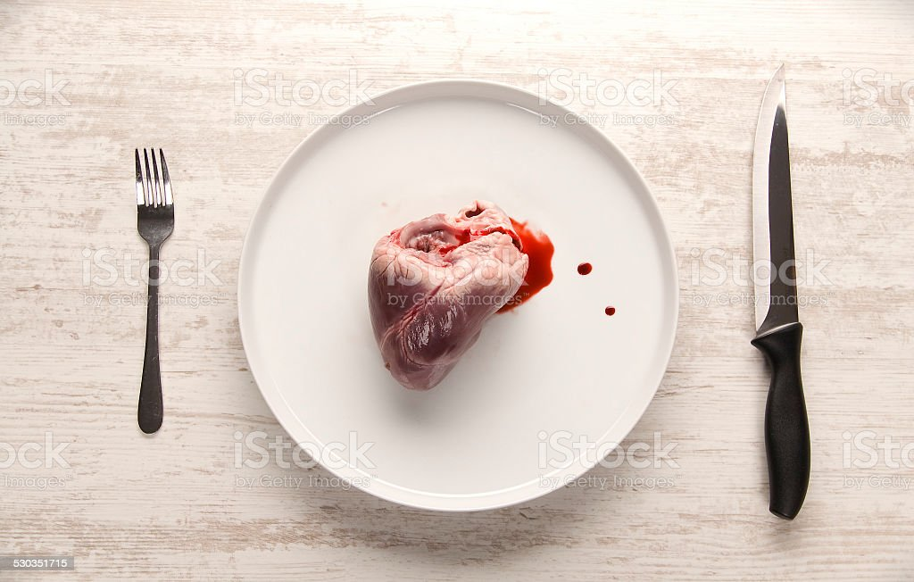 Pork heart on a white plate stock photo